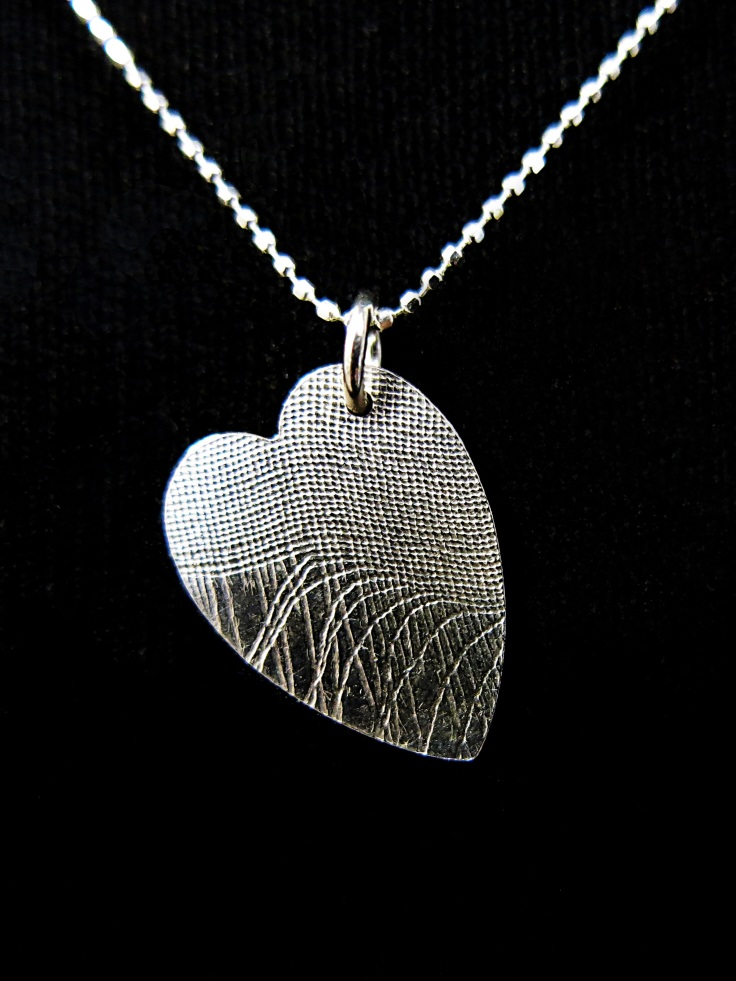 Sterling silver heart pendant by Tina Seviour